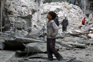 A boy inspects a damaged site after airstrikes on the rebel held Tariq al-Bab neighborhood of Aleppo, Syria. REUTERS/Abdalrhman Ismail